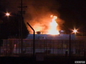 Flames leap from a housing unit at a prison in Chino, California, on Saturday night.