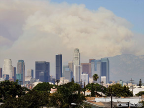 Smoke billows beyond the Los Angeles, California, skyline Saturday as fire raged in Angeles National Forest.