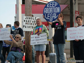 About 100 women's rights supporters were on hand Saturday outside an abortion clinic in Bellevue, Nebraska.