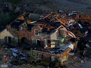 A large home stands in ruins after Tuesday night's tornadoes in Oklahoma.
