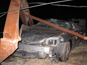 A car is severely damaged in the wake of a tornado Tuesday night in Lone Grove, Oklahoma.