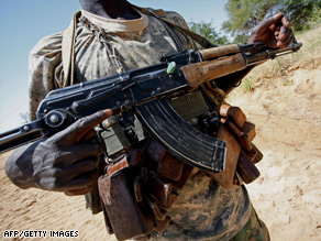 A member of the Justice and Equality Movement (JEM) stands guard near the Sudan-Chad border in 2007.