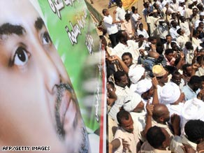 Sudanese demonstrators protest an arrest warrant for war crimes issued this week against President Omar al-Bashir.