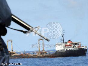A Canadian naval ship escorts a World Food Programme vessel into Mogadishu, Somalia, on September 18.