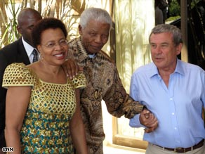 Nelson Mandela, accompanied by his wife Gracia Marcel, are greeted by Sol Kernzer.