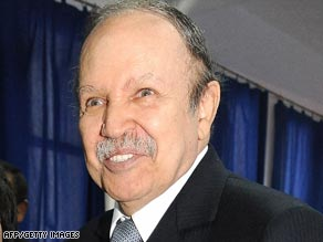Algerian President Abdelaziz Bouteflika arrives to cast his vote at a school in Algiers.