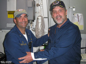 Capt. Richard Phillips, right, stands with U.S. Navy Cmdr. Frank Castellano after Phillips' rescue Sunday.