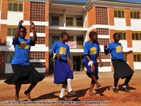 Orphans perform at the opening ceremony for their new home in Mutungo, Uganda.