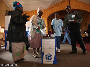 Elderly citizens cast their votes Tuesday in early voting in Alexandra township near Johannesburg.