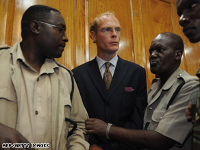 Thomas Cholmondeley, 40, is led into the courtroom in Nairobi, Kenya.
