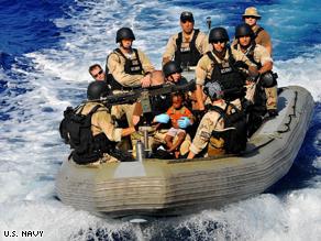 U.S. Navy rescues Somali men women and children stranded aboard a small skiff off Somalia's coast.
