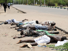 Bodies of hard-line Islamic rebels killed in battle lie in a Nigerian city. Civilians and troops also have died.