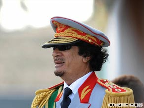 Libyan leader Moammar Gadhafi greets guests Tuesday at a military parade in Tripoli.