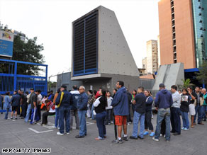 Venezuelans wait to vote on the referendum Sunday at a poll center in Caracas.