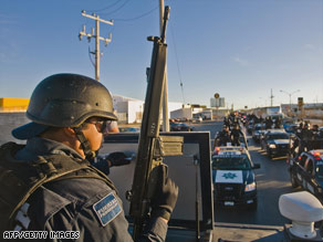 Mexican federal police patrol Monday on the streets of Ciudad Juarez, a major battleground for drug cartels.