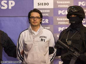 Vicente Carrillo Leyva is escorted by police at a news conference in Mexico City on Thursday.