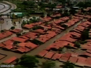 Floodwaters reach almost to the tops of some homes in Piaui state in Brazil.