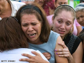 Relatives cry Saturday at the funeral for one of the children killed at a day care fire in Hermosillo, Mexico.