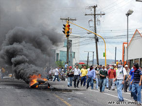 Zelaya's supporters burn tires Monday near the presidential palace in Tegucigalpa.