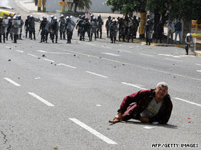 A demonstrator lies in the street during clashes between Zelaya supporters and police in Tegucigalpa on June 29.