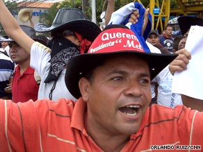 A protester rallies in support of ousted  President Jose Manuel Zelaya on Sunday in Tegucigalpa.