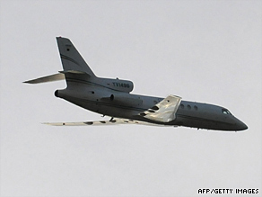 A plane carrying ousted Honduran President Manuel Zelaya flies over Tegucigalpa on Sunday.