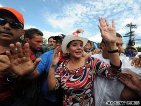 Honduran first lady Xiomara Castro de Zelaya joins a protest march Tuesday in Tegucigalpa.