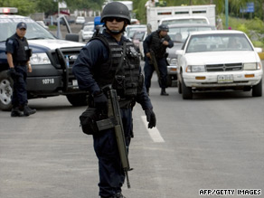 Federal policemen stand at a checkpoint in the state of Michoacan last week.