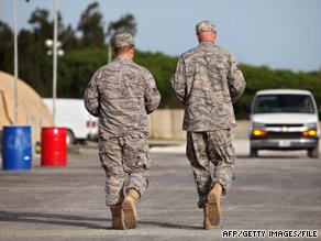 U.S. military personnel walk a road at the U.S. naval base at Guantanamo Bay, Cuba, in July.