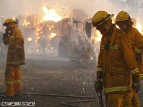Firefighters battle a blaze in Labertouche, about 125 kilometers west of Melbourne.