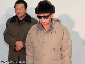 North Korean leader Kim Jong Il, right, in an undated photo that the state news agency released Saturday.