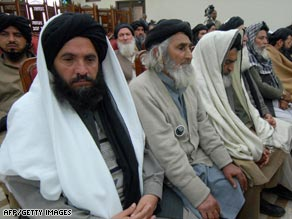 Delegation members of pro-Taliban leader Soofi Mohammad at a meeting in Peshawar Monday.