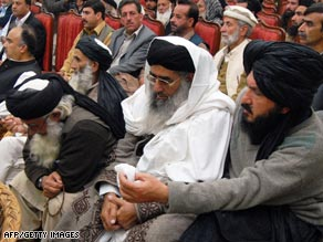 A pro-Taliban delegation attends a meeting with government officials in Peshawar, Pakistan, on Monday.
