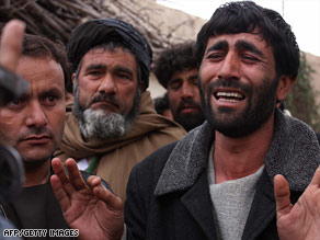 An Afghan man grieves for his brother after an attack this week by U.S.-led coalition forces.