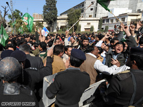Pakistani policemen struggle with supporters of former premier Nawaz Sharif in Rawalpindi.