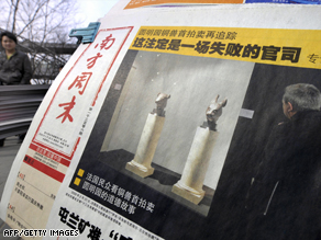 A Beijing news stand shows a report about the sale of the two bronze artifacts.