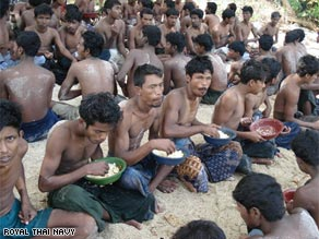 A photograph released by the Thai navy shows a group of men captured on December 12.