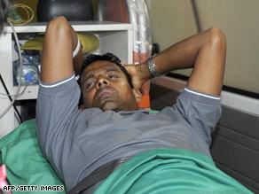 Sri Lankan player Thilan Samaraweera is taken aboard an ambulance Wednesday in Colombo.