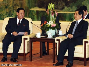 North Korean Prime Minister Kim Yong Il (left) visits Chinese President Hu Jintao in Beijing on Thursday.