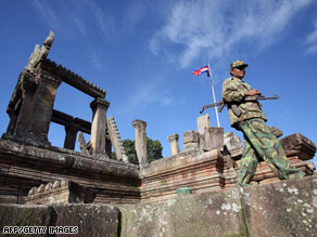 A Cambodian soldier walks past Preah Vihear temple in the Cambodian province of Preah Vihear on July 21.