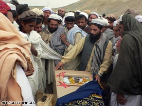 Tribesmen mourn a suspected U.S. airstrike victim in northwest Pakistan, scene of suicide attacks and airstrikes.