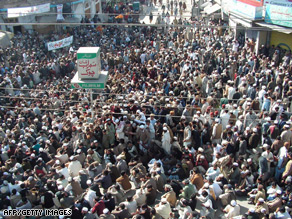Supporters of cleric Sufi Mohammad gather as they march during a peace rally in the Swat Valley.