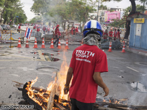 Violent protests have left two people dead and dozens injured in Thailand.