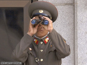 A North Korean soldier scans the southern side of the border at Panmunjom along the Demilitarized Zone.