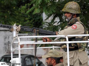 Pakistani paramilitary troops patrol a street in Islamabad on Tuesday.
