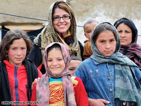 CNN's Atia Abawi, center, with Banafsha (denim jacket) and her siblings and mother.