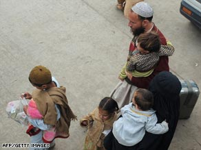 A family arrives in Rawalpindi after fleeing fighting in the Swat Valley.