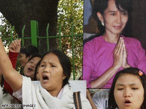 Pro-democracy supporters hold a portrait of Aung San Suu Kyi in New Delhi, India.