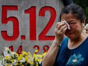 A relative of victims of last year's earthquake mourns in Beichuan County, China.