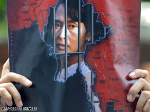 An activist holds a picture of Aung San Suu Kyi in front of the Myanmar embassy in Bangkok, Thailand, on Sunday.